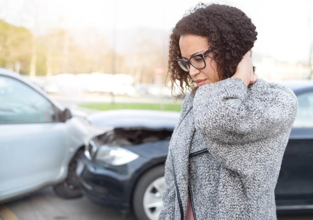 Woman who has whiplash from an auto accident
