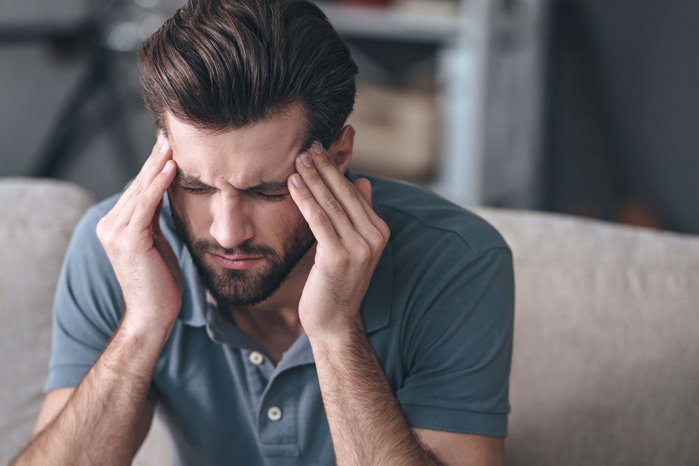 Man with headaches needs chiropractic care.